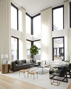 White and grey big living room.