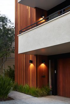 The siding used on this Eichler house remodel in San Francisco is vertical Kayu Batu wood.