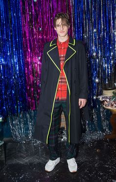 Hugo Hodgson in a Burberry coat and tartan trousers at the Burberry x Cara event in London
