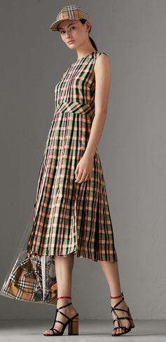 A sleeveless dress from #Burberry cut from light georgette in Italian-woven check. Detailed with a box-pleat skirt, the elegant A-line shape has a wide waistband for definition