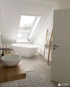 We love Mia's bathtub with a view! What a beautiful white bathroom.