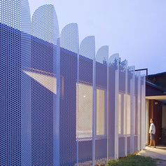 Perforated Wavy Metal Screens Are A Reference To Ancient Persian Arches