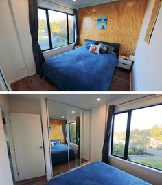A small bedroom in a shipping container house has a plywood accent wall.