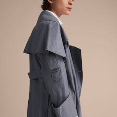 From the Burberry February 2017 Collection: An English-made Burberry trench coat cut for a relaxed, asymmetric silhouette in lightweight tropical gabardine. Available for pre-order now.
