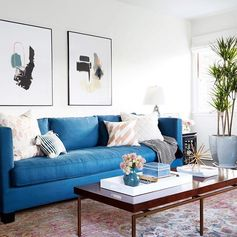 Indigo sofa + abstract modern art + antique persian rug = a pretty good combination of no fail design elements.  @zekeruelas (art by @Jaimederringer)