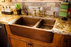 Tuscan kitchen sink...would be better with a single lever faucet and two full-sized sinks