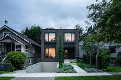 D'Arcy Jones Architects (DJA) has recently completed a new infill house in Vancouver, Canada, that's covered in dark shingles and has a sunken garage. #SunkenGarage #ModernHouse #DarkShingles #Landscaping #CurbAppeal  #ModernArchitecture