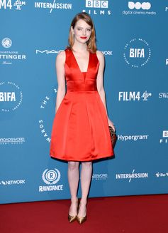 Emma Stone wearing a dress from the Louis Vuitton Cruise 2019 Collection by Nicolas Ghesquière, a Petite-Malle, pumps, ring, and earrings Louis Vuitton Jewellry. At the 21st British Independent Film Awards, on December 2, 2018 in London.