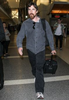 Christian Bale departs from LAX.