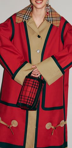 """ Our Burberry bonded cotton oversized seam-sealed car coat, finished with buckled straps"""