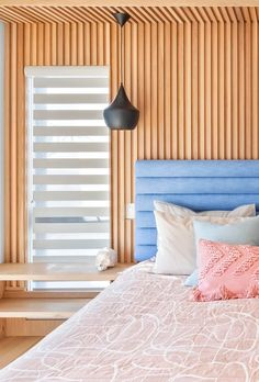A wood accent wall with vertical slats.