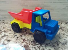 This was another thing found on Thingiverse. Toy Dump Truck by Barspin. http://www.thingiverse.com/thing:537153 It came together really well. I did slightly damage the PEI surface trying to pry the wheels from the print bed. I adjusted the Z lift and that resulted in a bit of lift from the bed on the back of cab as the ABS contracted resulting in the seem on the rear of the front fenders and cab. Every day I am more and more impressed with the MK2. #toysandgames #prusai3