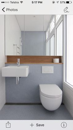 Image result for timber veneer wall panel with concealed cupboard in bathroom