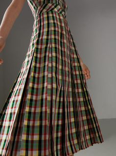 A #Burberry sleeveless dress cut from light georgette in Italian-woven check. Detailed with a box-pleat skirt, the elegant A-line shape has a wide waistband for definition