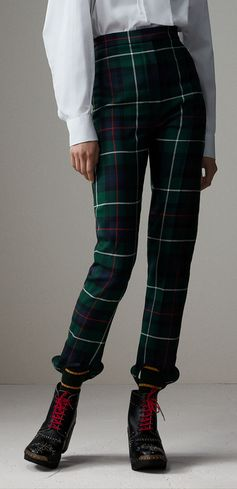 A pair of tailored stirrup trousers refined in Modern Robertson Hunting tartan wool twill. The slim, high-waisted silhouette is designed with a foot loop that references equestrian styles.