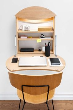 Designer Michael Hilgers has created RADIUS, a fold-down work station for people who don't need a desk every day. #WallDesk #FoldableWallDesk #DeskIdeas
