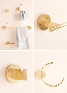 Modern metallic bathroom hardware with a brass finish.