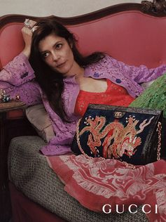 The Gucci Cruise 2017 campaign is set in Rome, home city of creative director Alessandro Michele, and shot by British photographer Mick Rock. Actress and singer Chiara Mastroianni with a Gucci Ophidia suede bag with embroidered dragon appliqué, GG and House Web details.