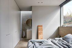 Minimalist bedroom with ensuite bathroom.