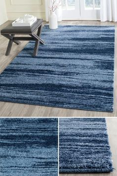 Usually abstract design is found in interiors on the wall in the form of art, however an abstract rug is an alternative idea for adding eye-catching art to the home. #AbstractRug #ArtisticRug #BlueRug #ModernRug #ModernDecor