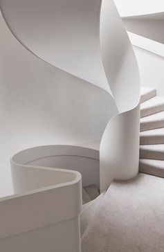 White spiral stairs in a modern house.