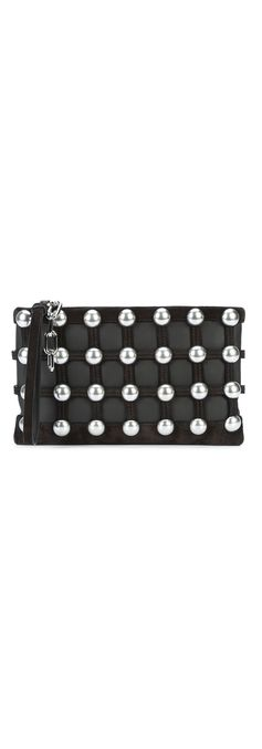 Evening clutch bags are an effortless way to bring edgy texture to your look. Alexander Wang's studded clutch bag is guaranteed to stand out from the crowd. Shop the Alexander Wang caged pouch clutch bag at Farfetch.