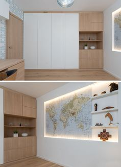Home Office Ideas - This modern office features a recessed world map and minimal shelving that's surrounded by hidden lighting, creating an eye-catching focal point for the room. #ModernHomeOffice #WorldMap #AccentWall #HomeOfficeIdeas