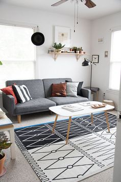 Their den space is a place to watch TV or work at the coffee table; Maria says they spend a lot of time cuddled up on this Wayfair couch together.