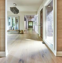 Light-toned wide plank wood flooring is often chosen for contemporary homes, as it adds visual interest to an interior without drawing attention away from other design elements. #WidePlankFlooring #LightWoodFlooring #FlooringIdeas