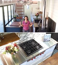 A tiny house kitchen with stainless steel countertops, full-size appliances, tile backsplash, and wood burning stove.