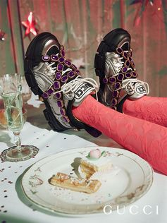 Appearing in the Gucci Gift 2018 campaign captured by artist and photographer Petra Collins, the new Gucci Flashtrek sneakers with removable elastic straps embellished by large crystals. Gucci / SEGA
