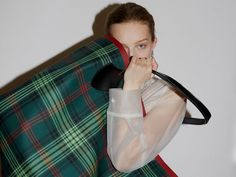 A supersized reversible tote in tartan check cotton bonded to supple leather. The unisex bag has contrasting sealed seams for an extra clash of colour.