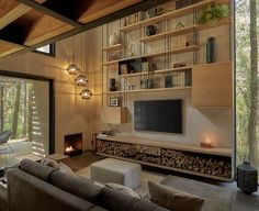 Open Wood Shelving Helps Fill Out This TV Wall