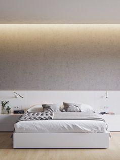 chambre claire en blanc neige, lit deux places, peinture grise et revêtement de sol en parquet massif