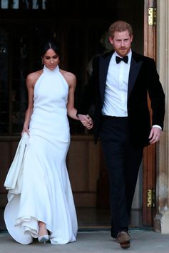 Congratulations to the new Duke and Duchess of Sussex! Ms. Meghan Markle wears a bespoke Stella McCartney high neck lily white gown in silk crepe to their Wedding evening Reception in Windsor.