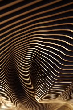This undulating ceiling installation is composed of laser cut MDF fins with a black finish. #SculpturalCeiling #CeilingInstallation #Sculpture #RestaurantDesign
