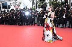 Amber Heard is a vision in a Valentino Fall/Winter 2018-19 multiflowers dress by Creative Director Pierpaolo Piccioli during the 'Sorry Angel' premiere at the Cannes Film Festival. #Cannes2018