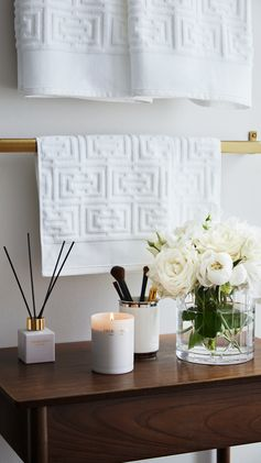 H&M HOME | Enjoy every minute of your bathroom routine with scented candles, soft hand towels and elegant porcelain toothbrush (or makeup brush) holders.