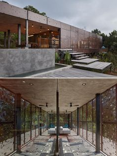 Metal screens with a perforated pattern create unique shadows for an enclosed patio.