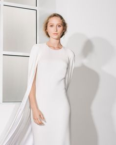The caped 'Violet' dress from the new Stella McCartney bridal collection is a powerful cut destined to make an entrance. The collection uses sustainable updates on luxurious couture fabrics. Pieces can be customised and tailored in-store; arrange an appointment on StellaMcCartney.com.