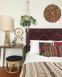 textile instead of headboard, mix matched textiles and bohemian decor