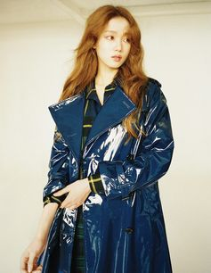 Lee Sung Kyung wears a navy Burberry laminated cotton trench coat in the December edition of Marie Claire KR, photographed by Mok Jung Wook