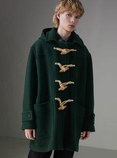 A #GoshaRubchinskiyxBurberry duffle coat with oversized beechwood toggles, updated with a detachable hood and protective gabardine seams