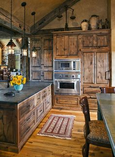Knotty alder.. I would love having a cabin up in Mammoth or somewhere in the mountains with a kitchen/cabin look like this!