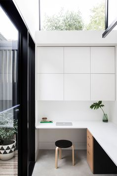 A Contemporary Shed-Like Addition Was Added To This 1930's House