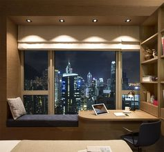 As part of a co-living / workspace in Hong Kong, Adapa Architects Limited designed a bedroom that features a combined window seat and desk. #BedroomIdeas #BedroomDesign #WindowSeat #BuiltInDesk #DeskIdeas