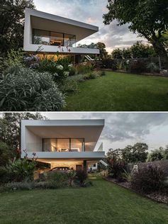 A white modern house extension with a wrap around balcony.