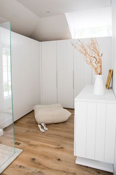 Closet Ideas - This modern master bedroom suite includes a walk-in closet, that features white panel cabinetry wardrobe doors, while a clerestory window adds natural light to the space. #WalkInCloset #WalkInWardrobe #MasterSuite #BedroomIdeas