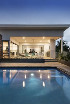 This stylish split-level residence is a seamless blend of Mid-Century Modern and Industrial design styles, with textures, materials and colours working in harmony. Designed for year-round entertaining, it features a central pool and alfresco area.