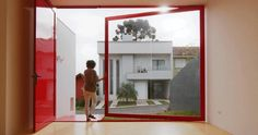 A Large Pivoting Window Opens This House To The Front Yard